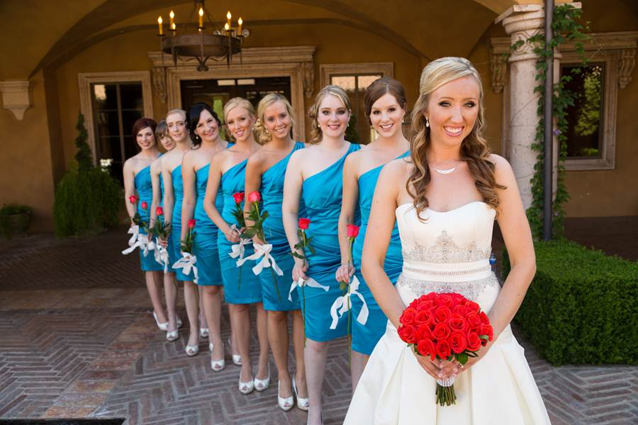 The Bridesmaids Wore Turquoise Dresses With A Single Shoulder Strap And Carried Red Rose White Ribbon Tied Around It They Heels